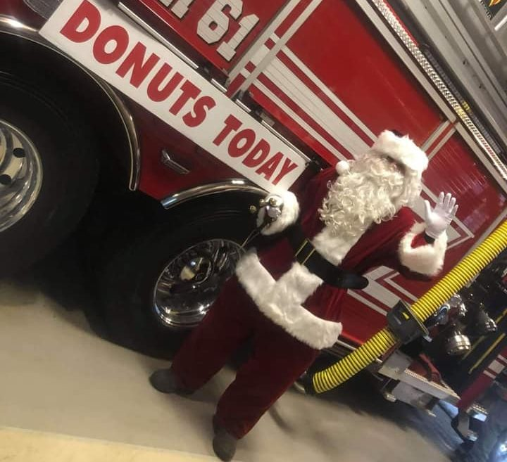 "Santa in front of Kimberton Fire Company truck ""Tower 61""."